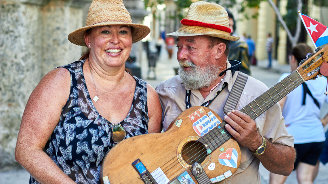 tourist enjoying music in the street, travel to cuba