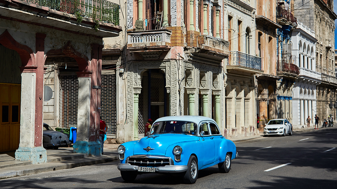Vintage American car from 50s cruising the streets of Old Havana, Joanna Lumley's documentary film