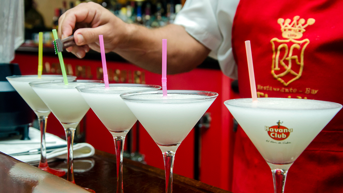 Bartender places several Daiquiris in the bar of El Floridita in Old Havana, Cuba