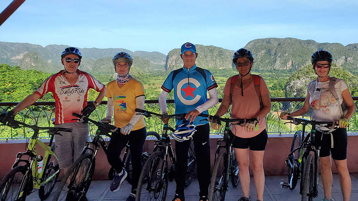 Tour guide Liesner Crespo and a group of cyclist in Vinales, Cuba