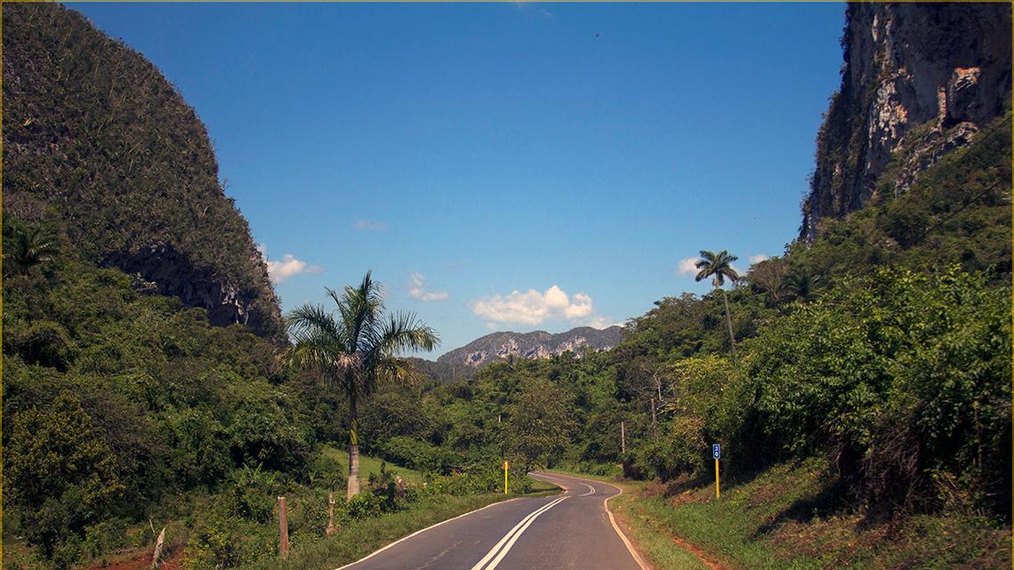 Flat, winding road between 'mogotes' near Vinales Valley in Pinar del Rio, Cuba