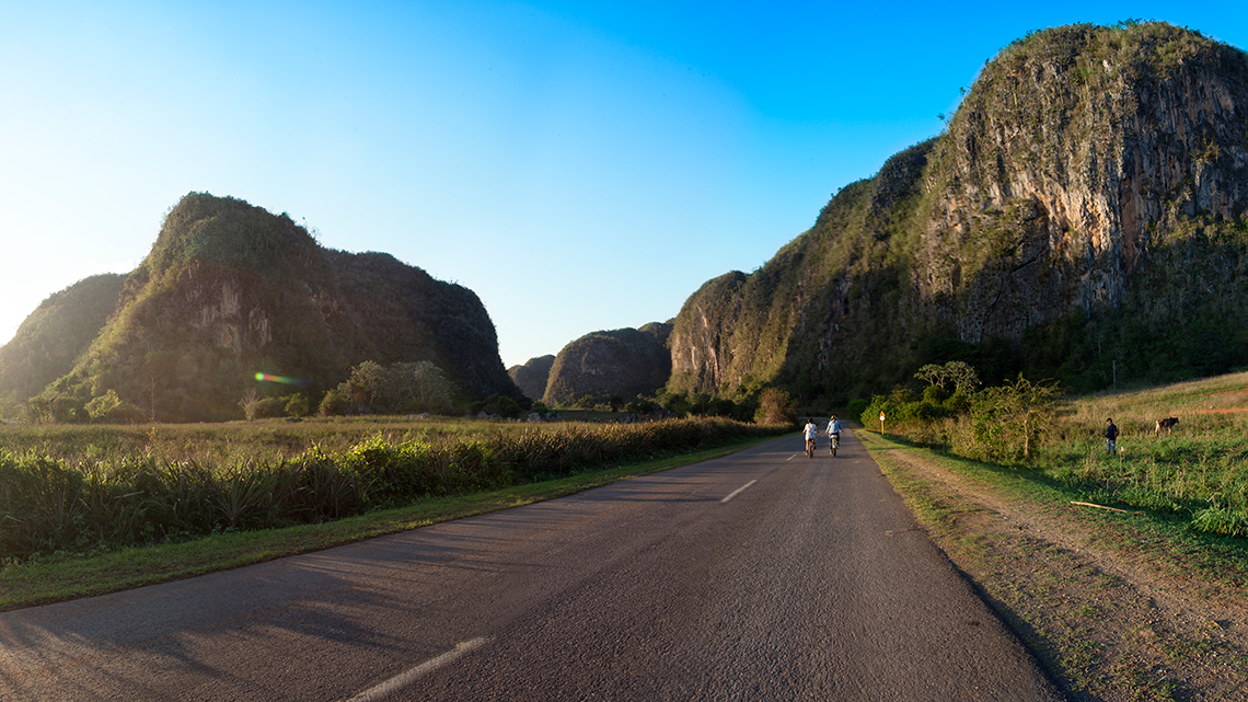 Tourist riding bikes in the roads around Vinales Valley