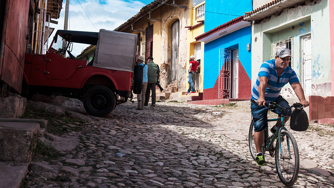Cyclist raiding the bumpy streets of Trinidad, Cuba