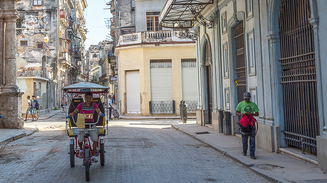 Bicitaxi travels the street of Old Havana, Cuba