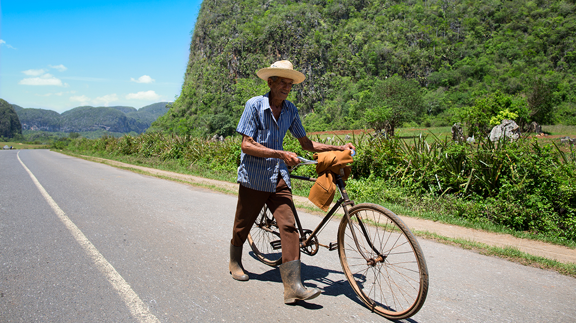 Cuban farmer walks with his bikes in Vinales, Cuba