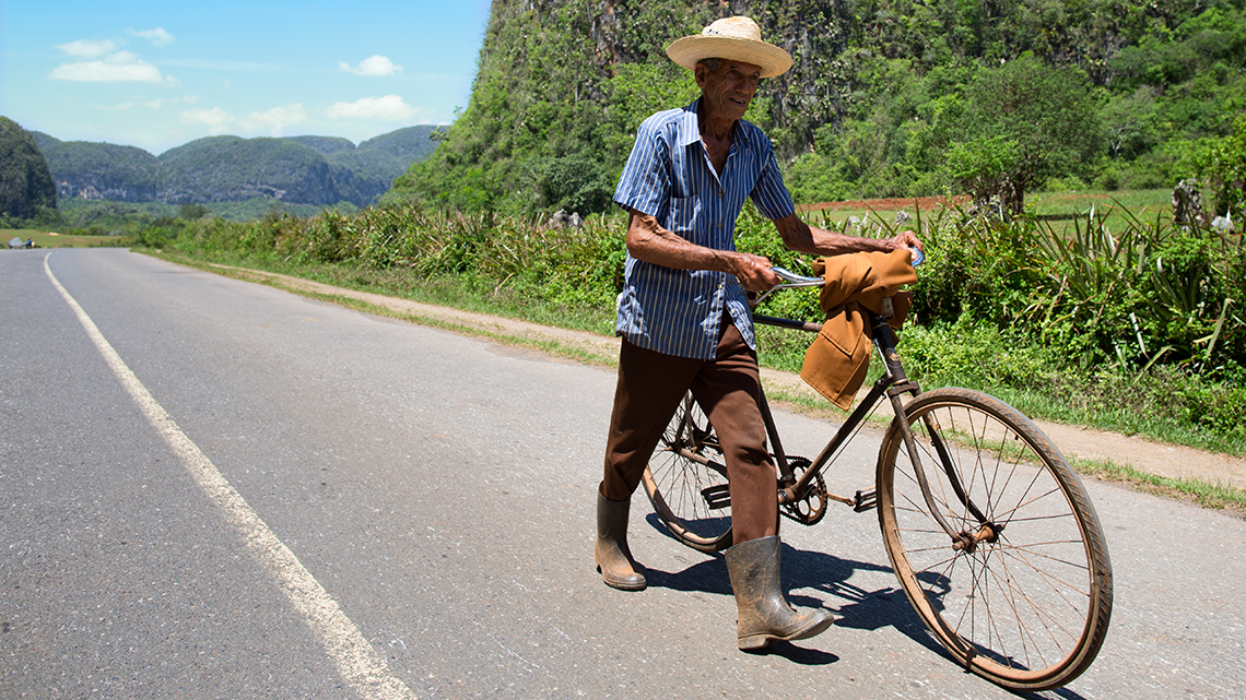 Cuban farmer and his old, trusted, chinese-made, Flying Pigeon bike