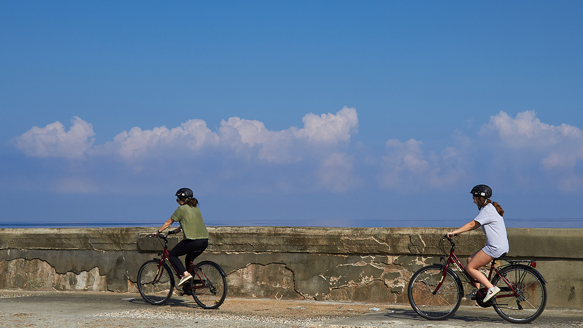 Tourist riding their rented bikes along the Malecon
