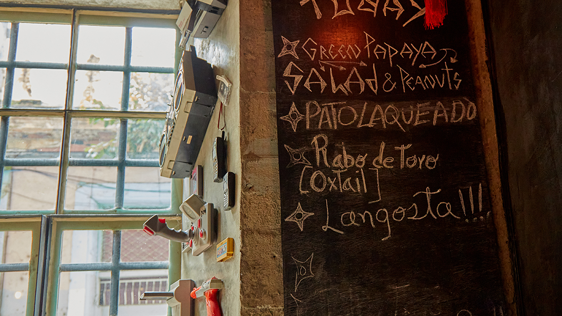 Menu of the day displayed on the wall of Jama Paladar