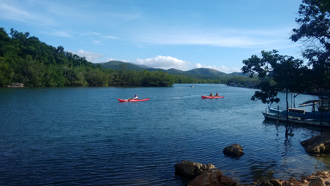 Lovely vistas of Escambray mountains while kayaking around Cienfuegos