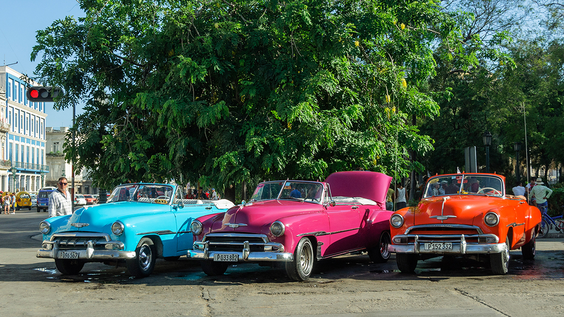 Vintage american cars parked near Havana's Parque Central