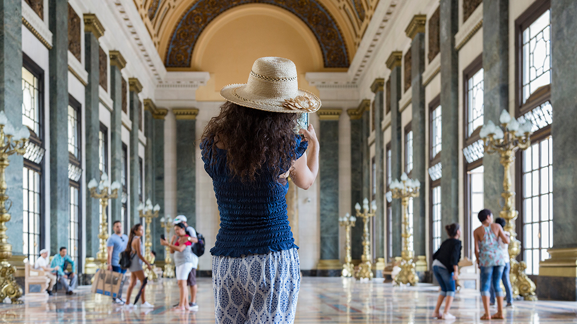 Tourist taking a photo of 'Salon de los Pasos Perdidos' in Havana's Capitol Building