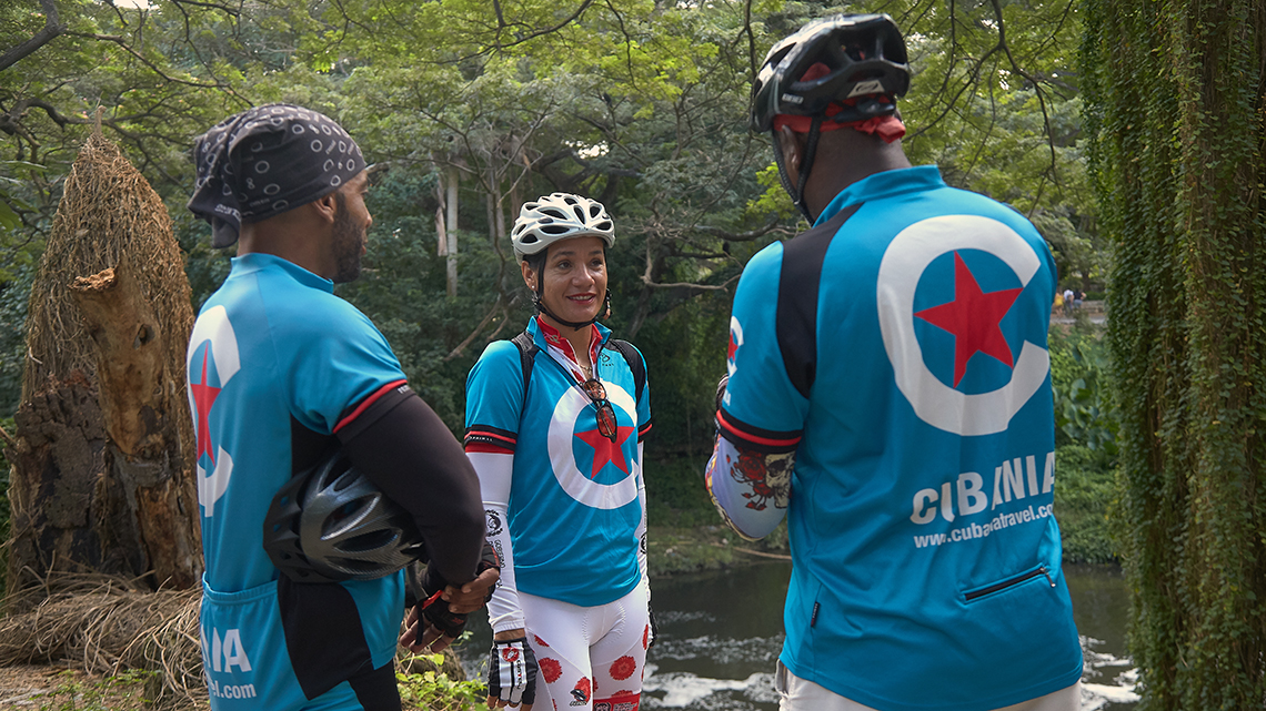 Yoanka Gonzalez (center) chatting with two other Cubania Travel guides during a cycling tour of Havana