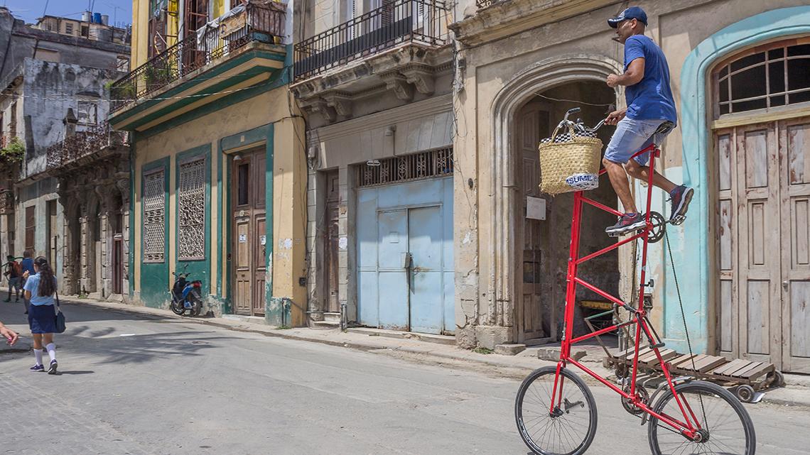 Félix Ramón Guirola riding the World's Tallest Bike in Old Havana