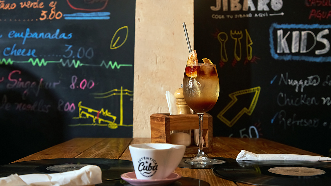 Menu and mocktail in one of the tables of Paladar Jibaro in Havana