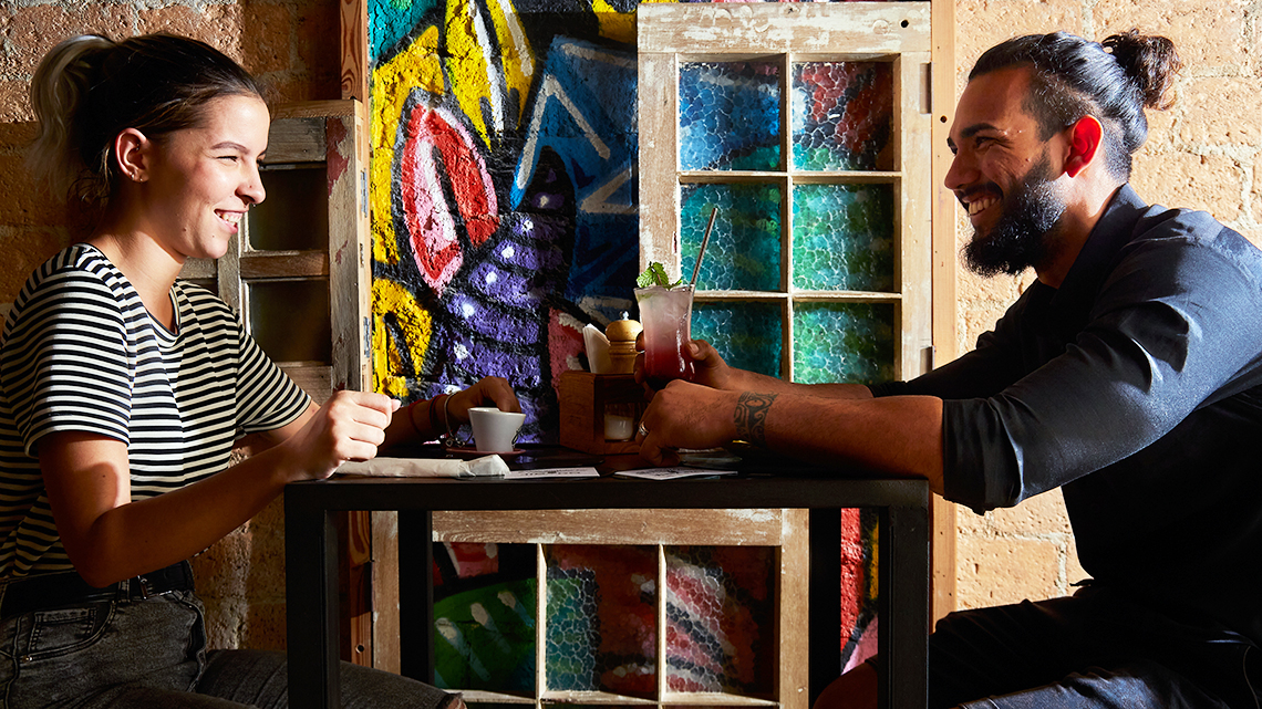 Friends share a coffee and a cocktail at Paladar Jibaro in Old Havana