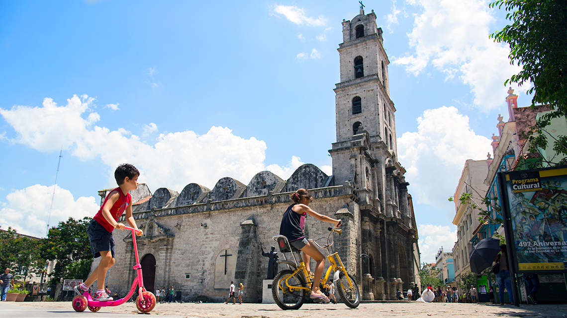 Kids playing in their bikes in Plaza San Francisco de Asis of Old Havana