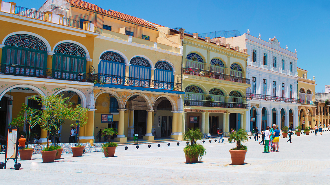 Colourful facades of the buildings around Plaza Vieja in Old Havana, Cuba