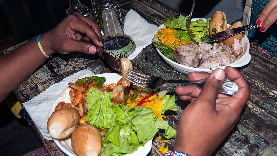 Travellers enjoy 'La Completa del Dia' at El Chanchullero de Tapas in Havana