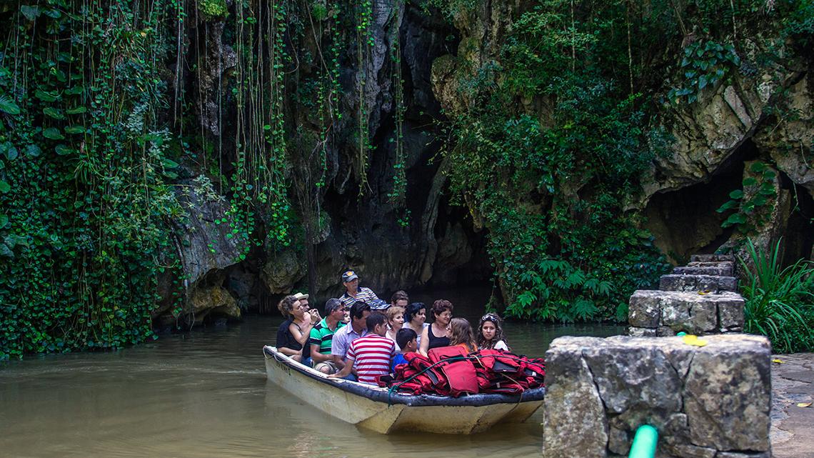 Boat with tourist leaving La Cueva del Indio