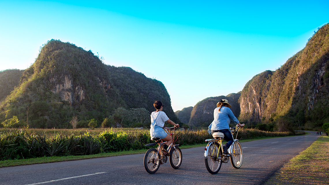Tourist discovering the Vinales Valley in bike