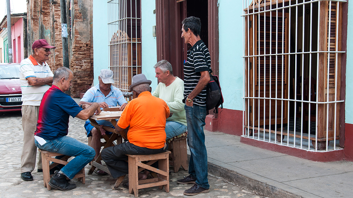Citizens of Trinidad playing dominoes in the streets of the city