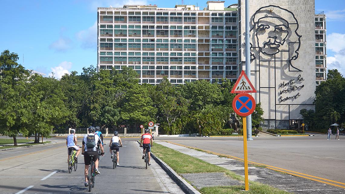 Cyclist touring Havana's Plaza de la Revolucion with Cubania Travel
