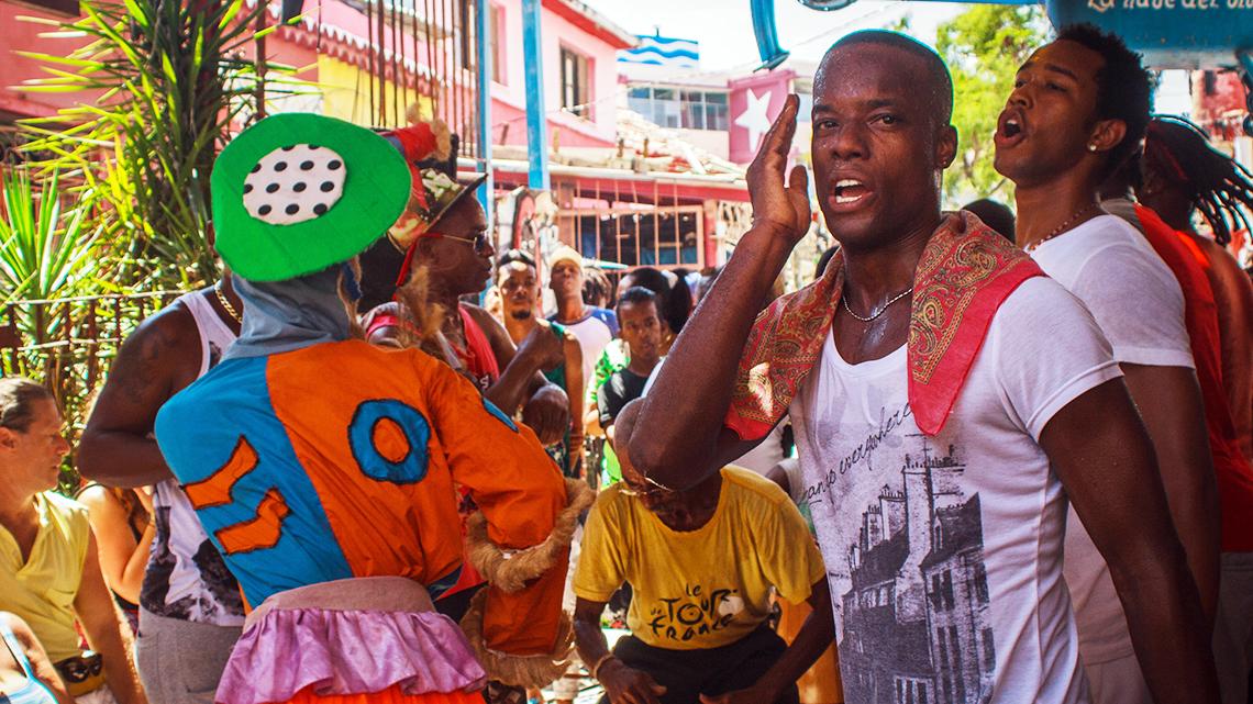 Local artists singing and dancing rumba in Callejon de Hamel, Havana