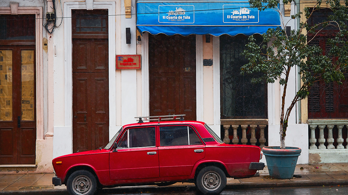 Old Soviet Lada parked in front of the entrance of El Cuarto de Tula