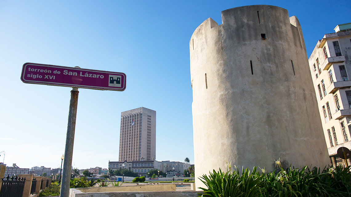Torreon de San Lazaro and its sign, in the background Hermanos Ameijeiras Hospital
