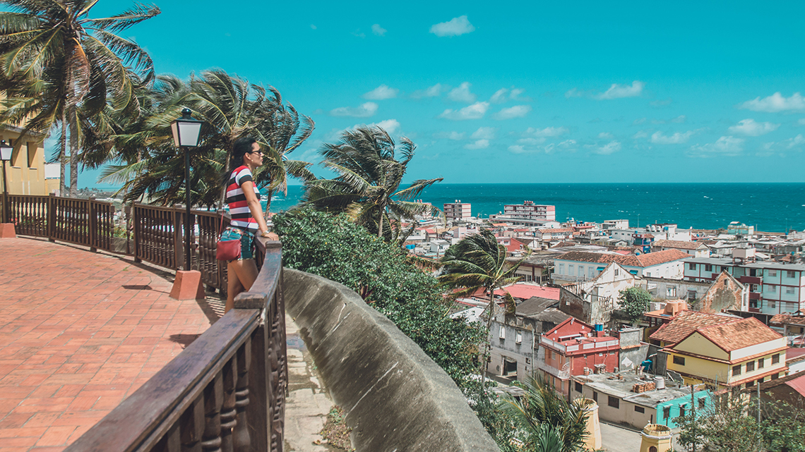 Tourist admiring the beatiful views of the sea and the city of Baracoa