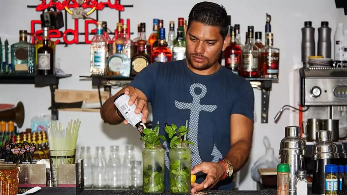 Barman prepares a mojito at paladar O'Reilly 304