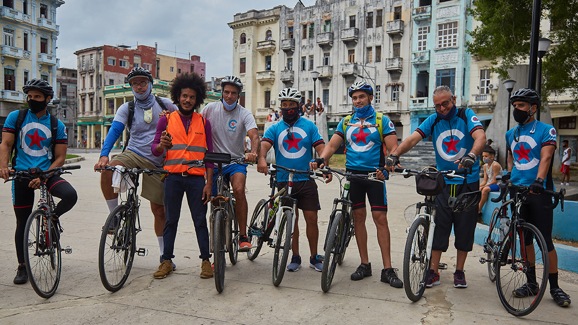 Cubania Travel team joins Yasser Gonzalez for a quick photo before starting Critical Mass