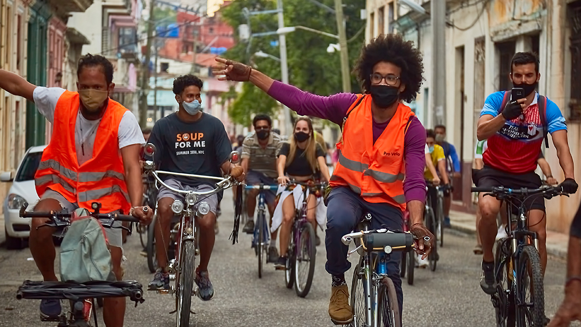 Members of Bicicletear La Habana guide the Critical Mass in a difficult junction of Old Havana
