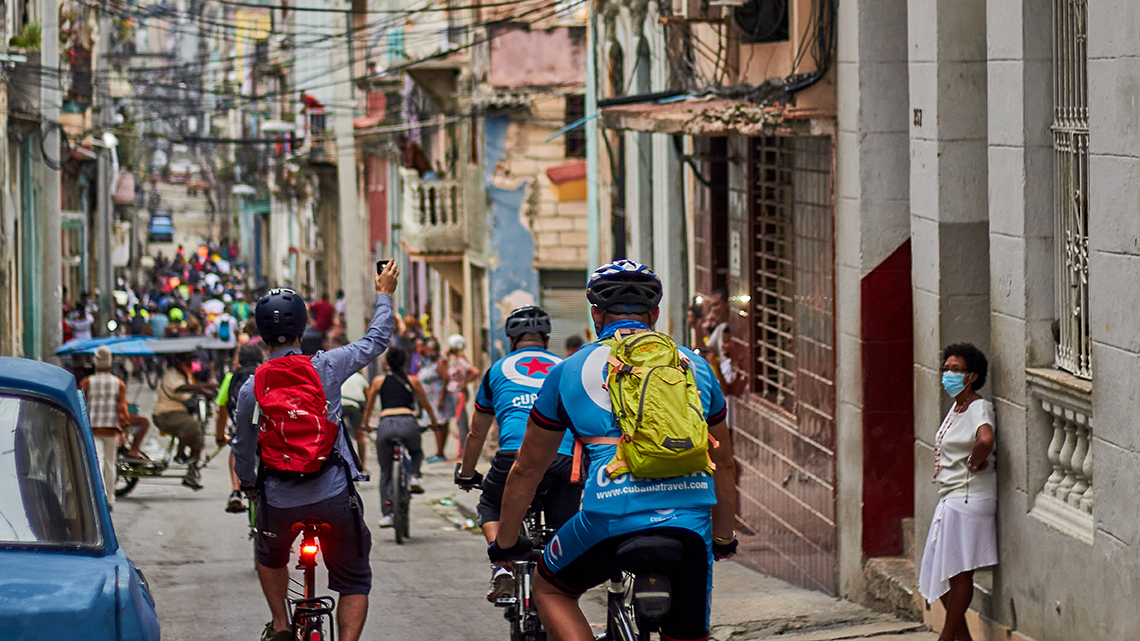 Cyclist taking a photo of the 'snake' that forms Critical Mass in the narrow streets of Old Havana