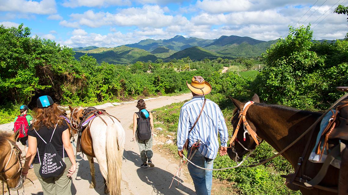 Tourist touring the mountains of El Escambray in Central Cuba