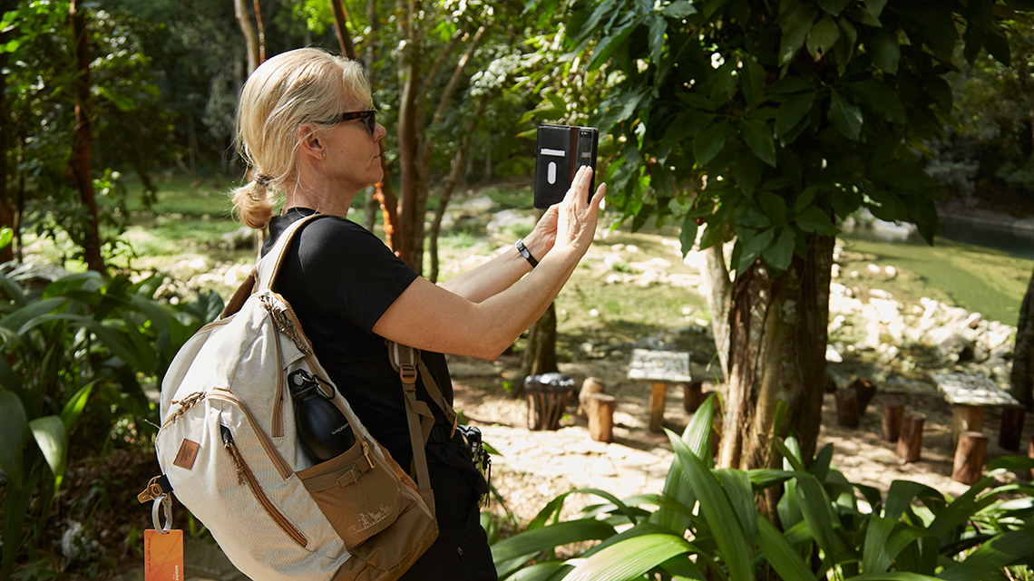Traveller taking pictures of the local flora in Las Terrazas, Cuba