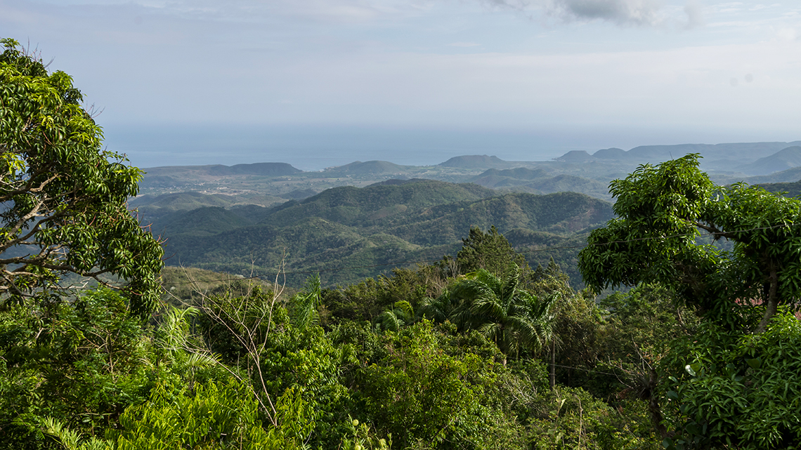 Sierra Maestra mountains in Baconao National Park, in the background the Caribbean Sea
