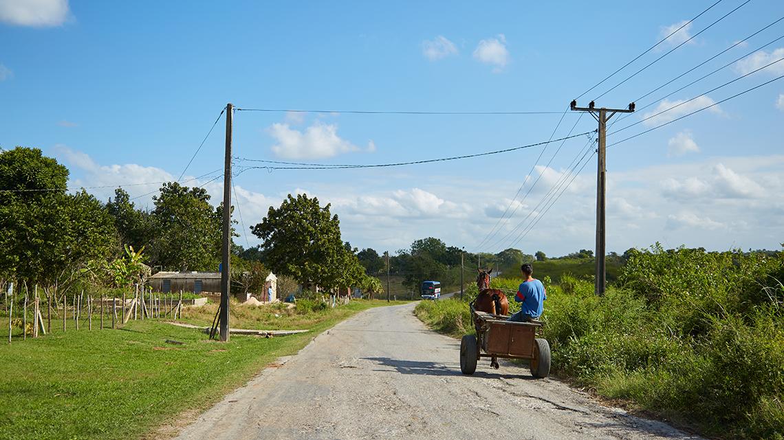 Farmers drive their horse drawn carriage around Las Terrazas