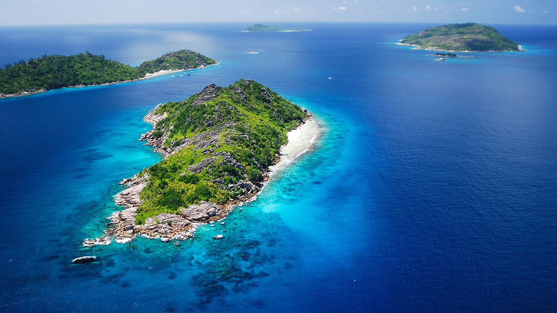 Beautiful aerial view of the Indian Ocean around Felicite and Sisters Island in the Seychelles