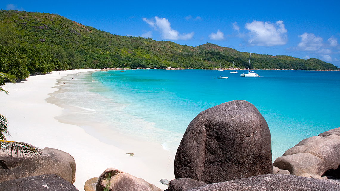 Boats arriving to the shores of Anze Lazio in Praslin Island, Seychelles