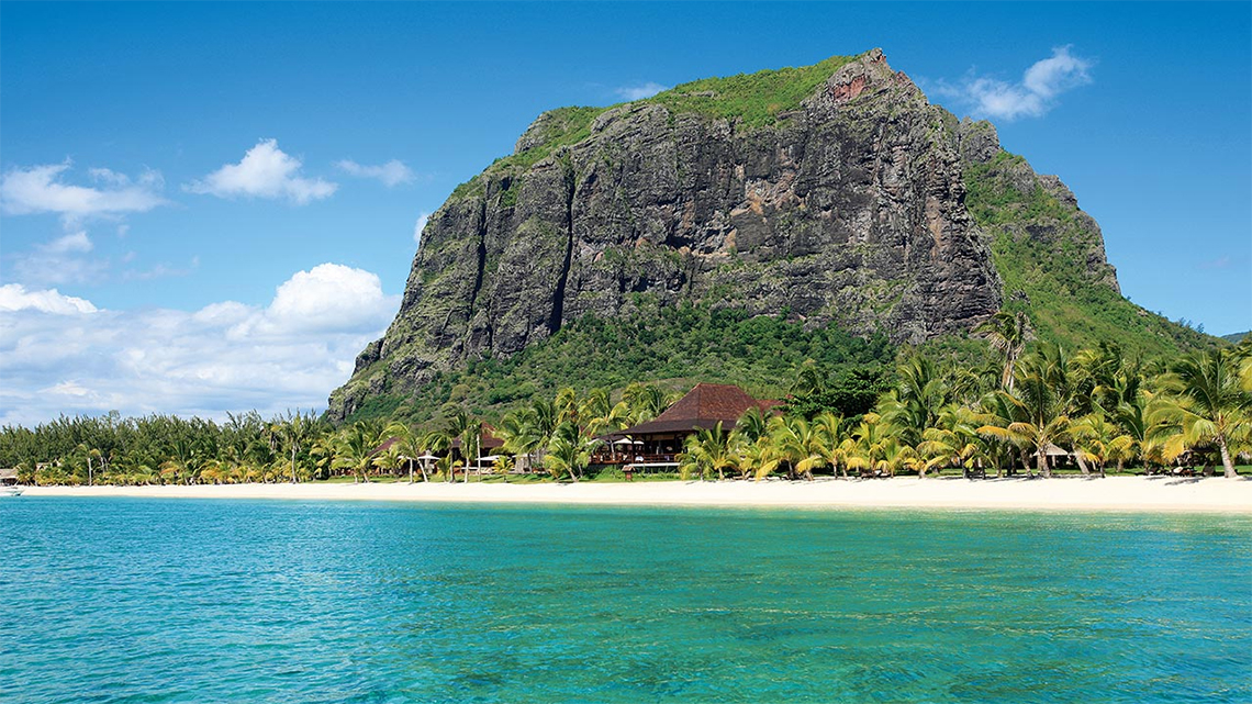 Le Morne beach, in the background Le Morne Brabant and the  LUX* Le Morne Mauritius hotel